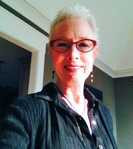 A selfie taken in the morning sunshine at home on Aug. 5, 2014. 'Betty,' my wig, is retired and I'm enjoying my transition hairstyle. It's nearly care-free and no blow drying means saved time.